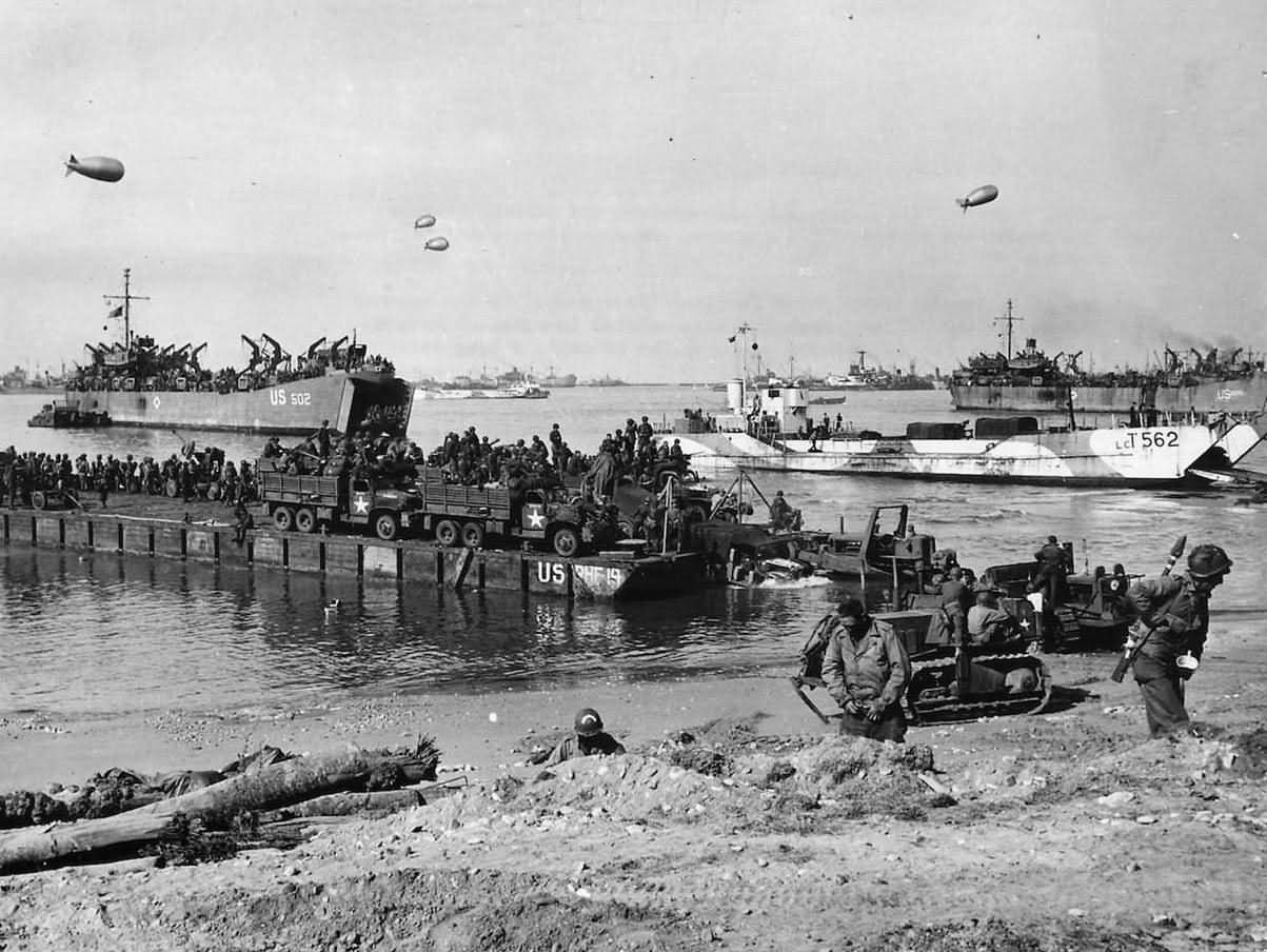111th Naval Construction Battalion Landing at Omaha Beach D-Day Normandy 1944. LCT-562 and USS LST-502 in the background