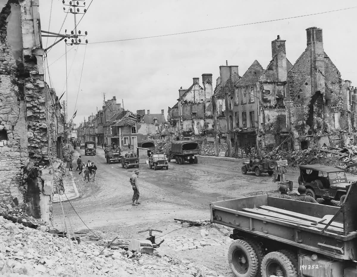1st Army Trucks and Jeeps in Ruins of Isigny Normandy 1944