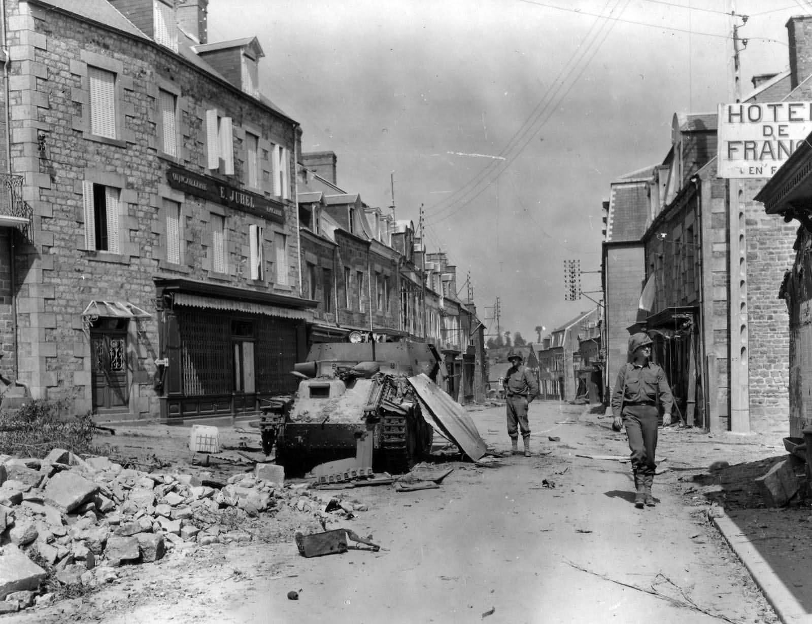 35th Infantry Division Troops And Wrecked Flakpanzer 38(t) In Tessy Sur Vire France 1944