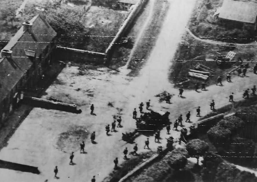 American soldiers file thru St. Jacques De Nehou enroute to Barneville and Carteret Normandy