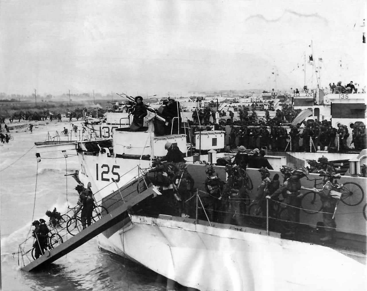 Canadaian bicycle Troops land at Juno s Nan White Beach on D-Day
