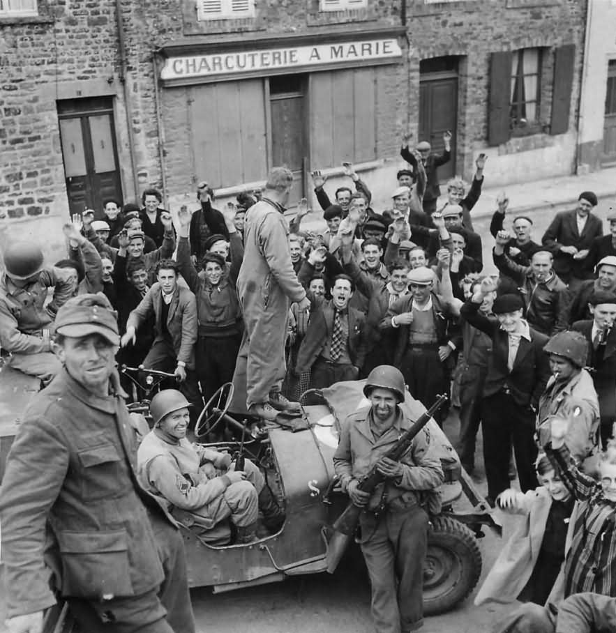 Civilians Cheer US Forces Entering Barneville France June 1944