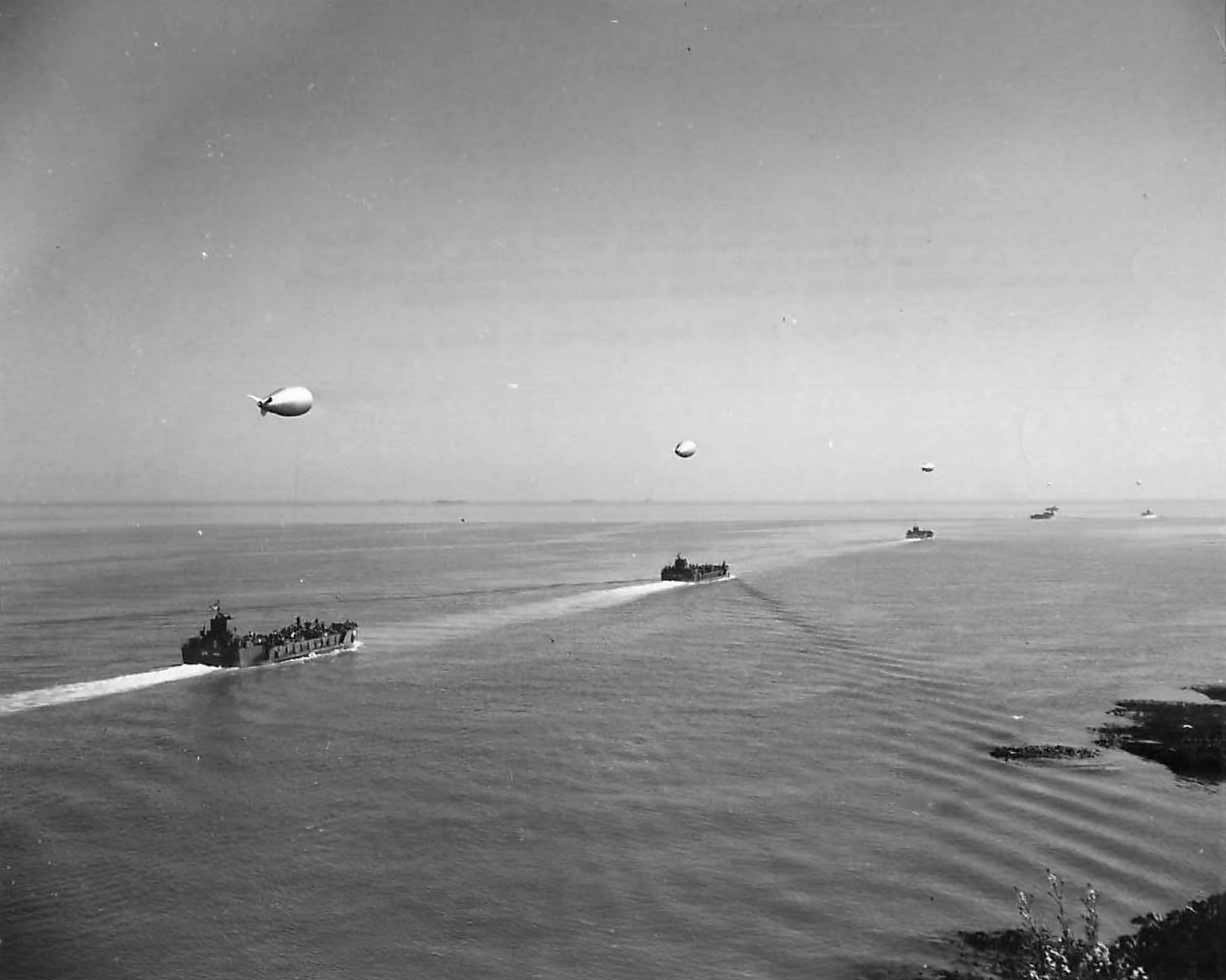 Convoy of LCTs and barrage balloons preparing for D-Day Invasion