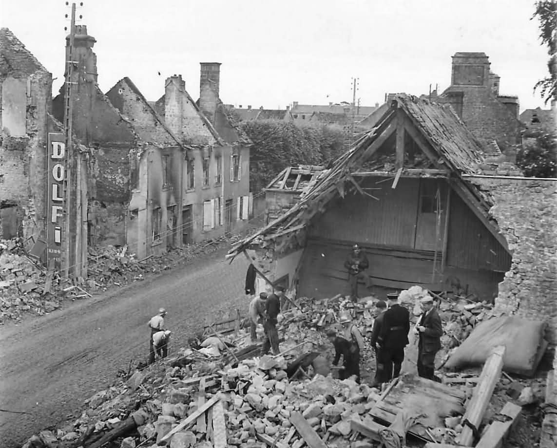 French Civilians and Firemen Start Reconstruction in Carentan Normandy 1944