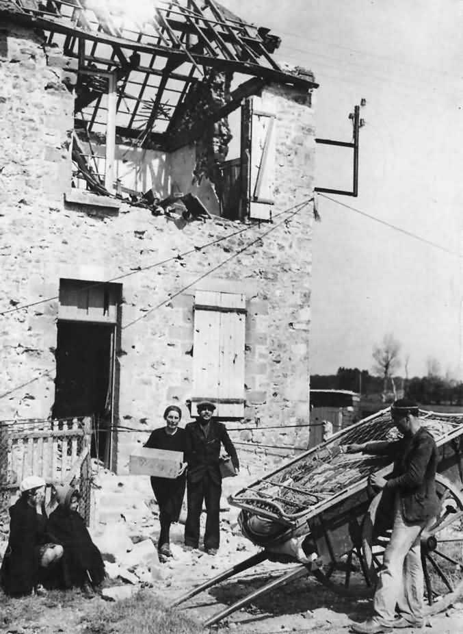 French Family Leaving Ruins of Their Home in Carentan Normandy 1944