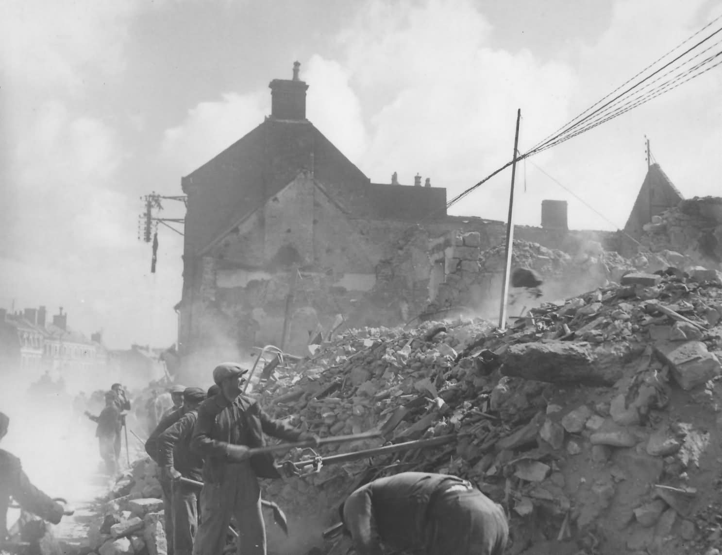French Refugees Digging Through Rubble Isigny sur Mer Normandy June 1944