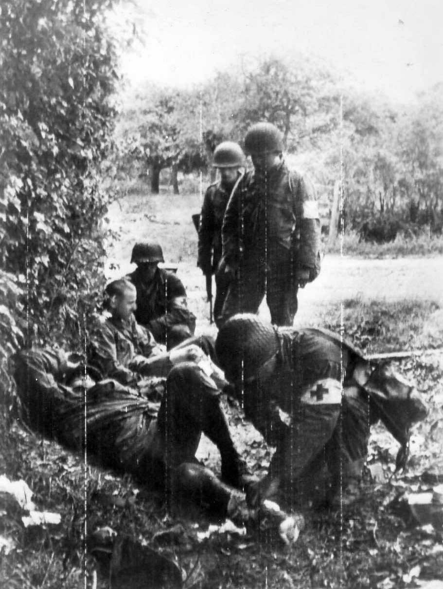 GI shot by German sniper near Cherbourg, 25 June 1944