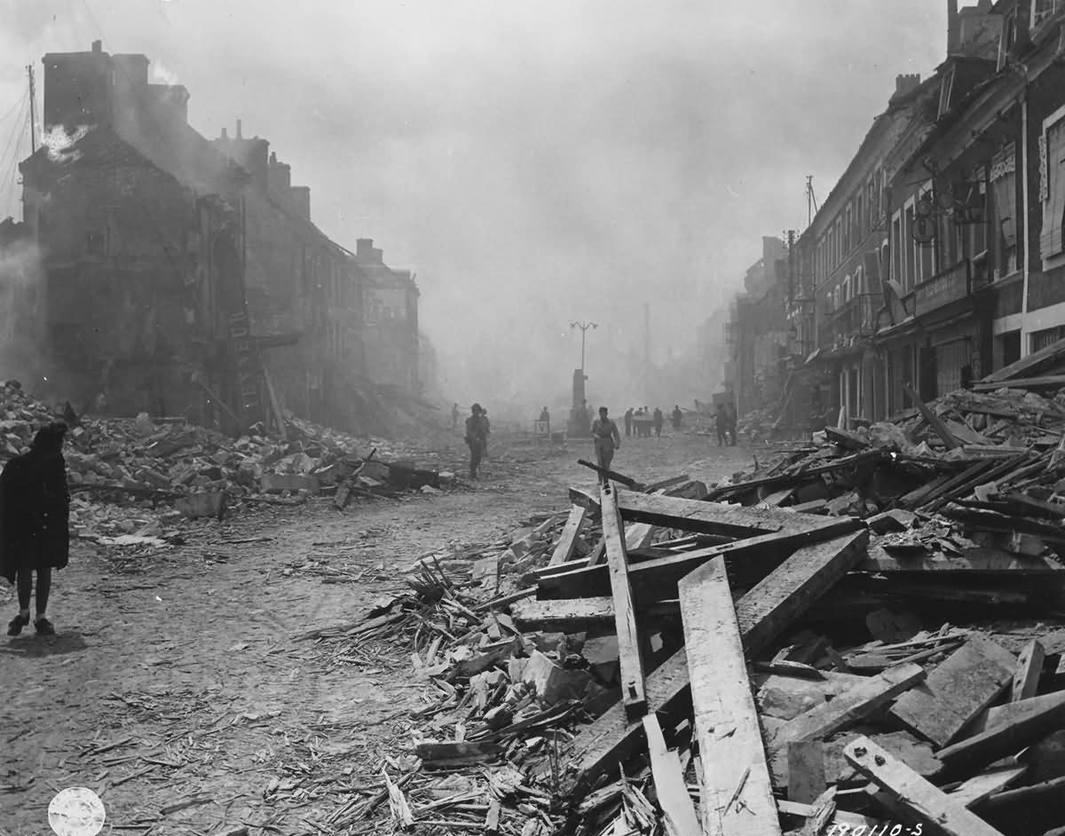 GIs in main street of Isigny June 11 1944 France 1944 Normandy