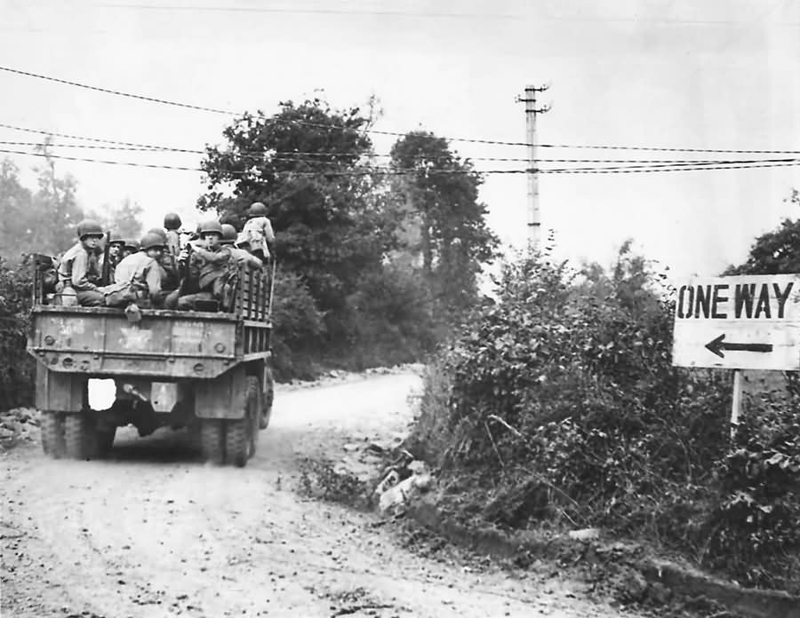 GMC truck loaded with US troops of the 4th Infantry Division move up to the front on July 23rd for Operation Cobra assault between the judge and Chapelle in Hébécrevon