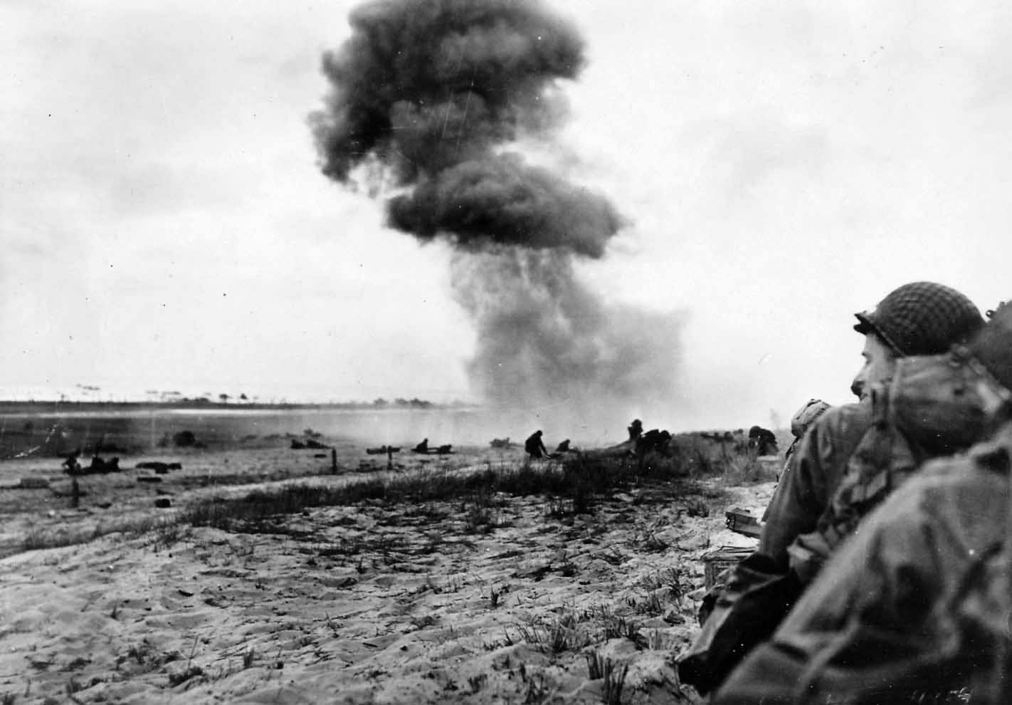 German 88 mm guns pound GIs on beach