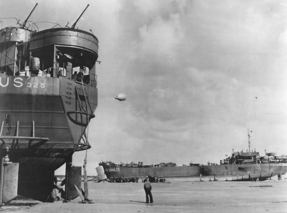 Landing Ship, Tank USS LST-326 and LST-388 Unloading on Normandy Beach during Low Tide June 1944