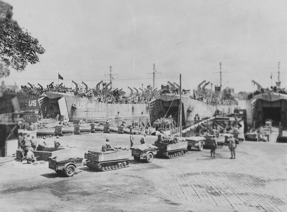 LSTs loading tracked vehicles carts for D-Day assault in England