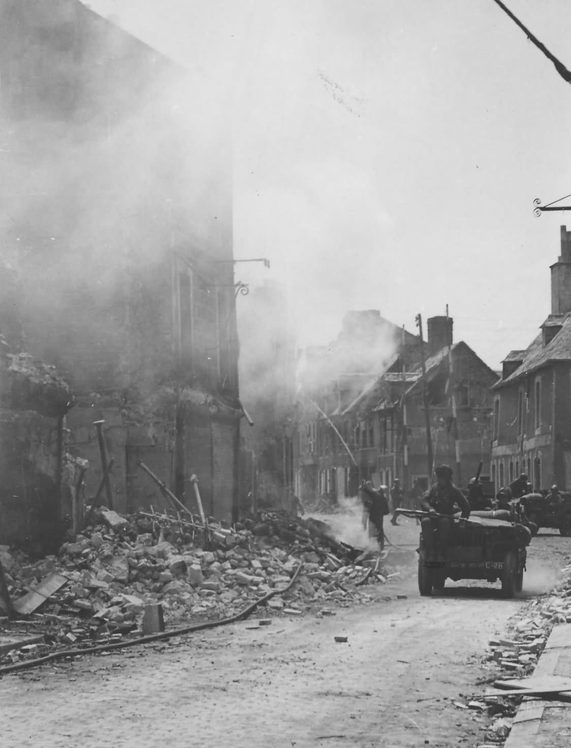 Photo Fireman Put Out Fire in Carentan Normandy France 1944