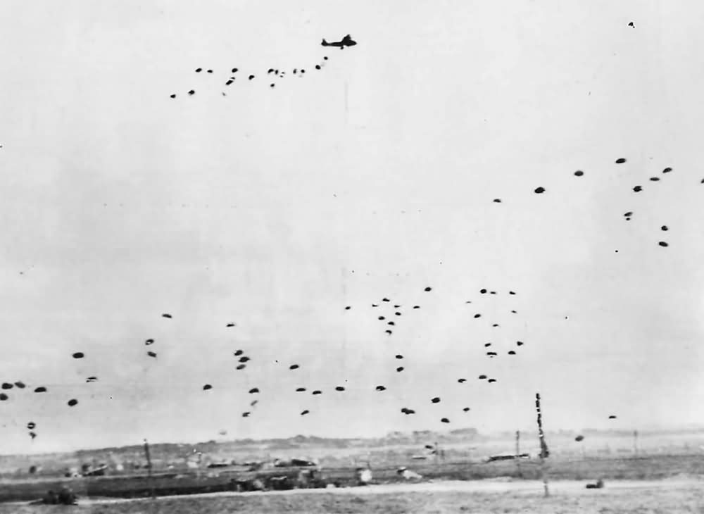 RAF aircraft drop supplies by parachute to British Airborne Division in Normandy 1944