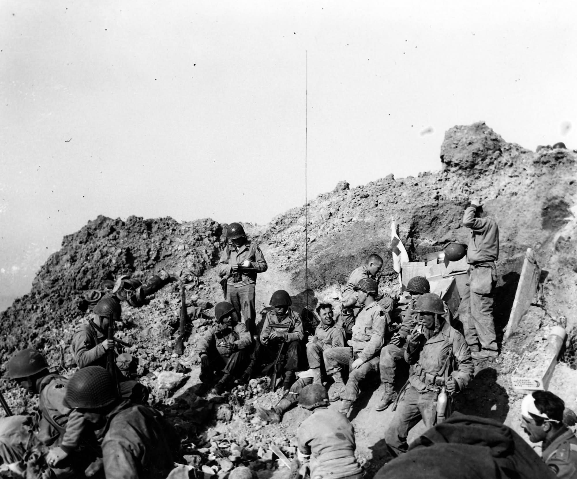 Rangers rest atop the cliffs at Pointe du Hoc 6 June 1944