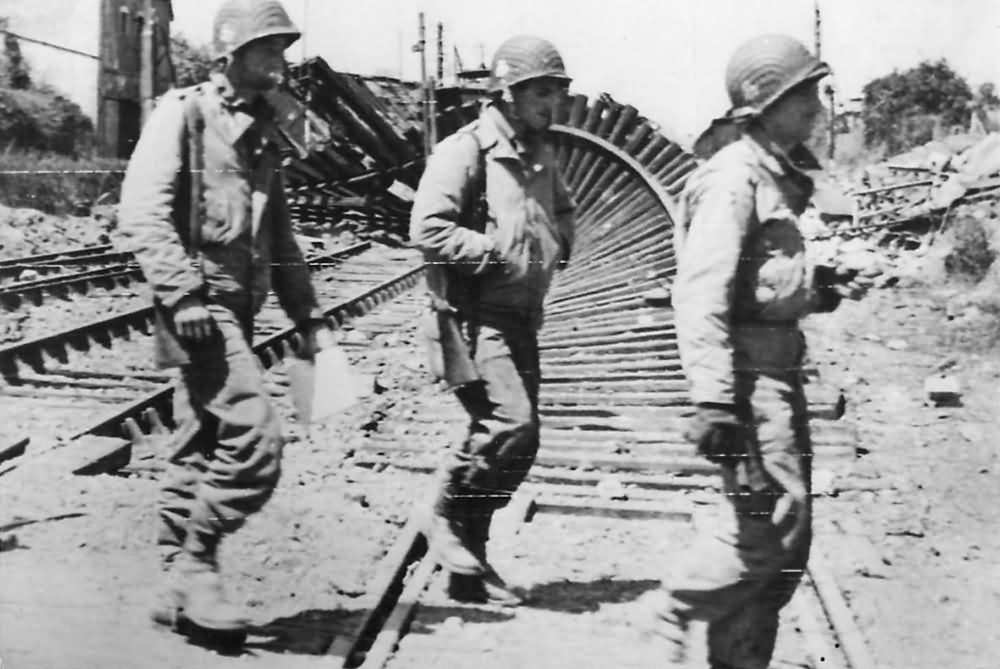 Soldiers of 327th Glider Infantry Regiment amid Ruins of Carentan 1944 Normandy