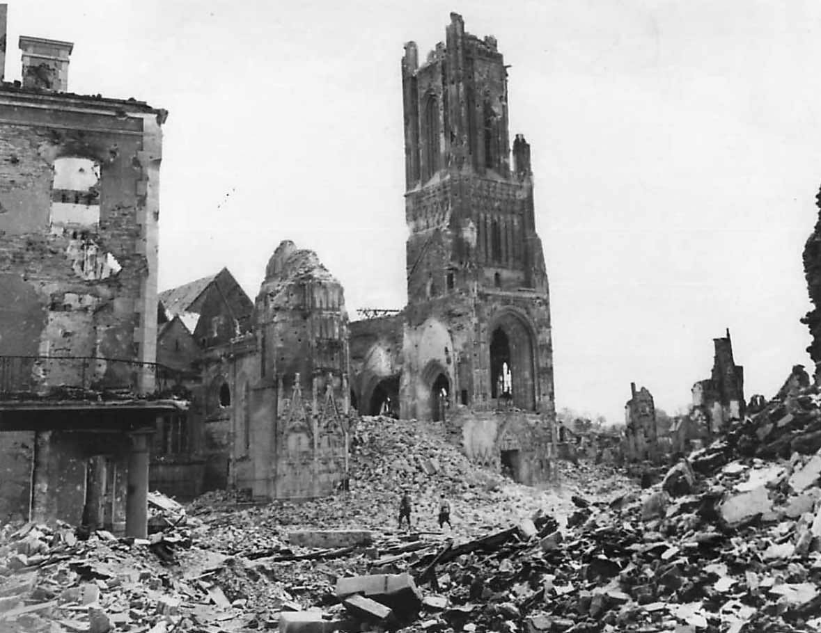 Soldiers view ruins of Notre Dame Cathedral in St. Lo Normandy