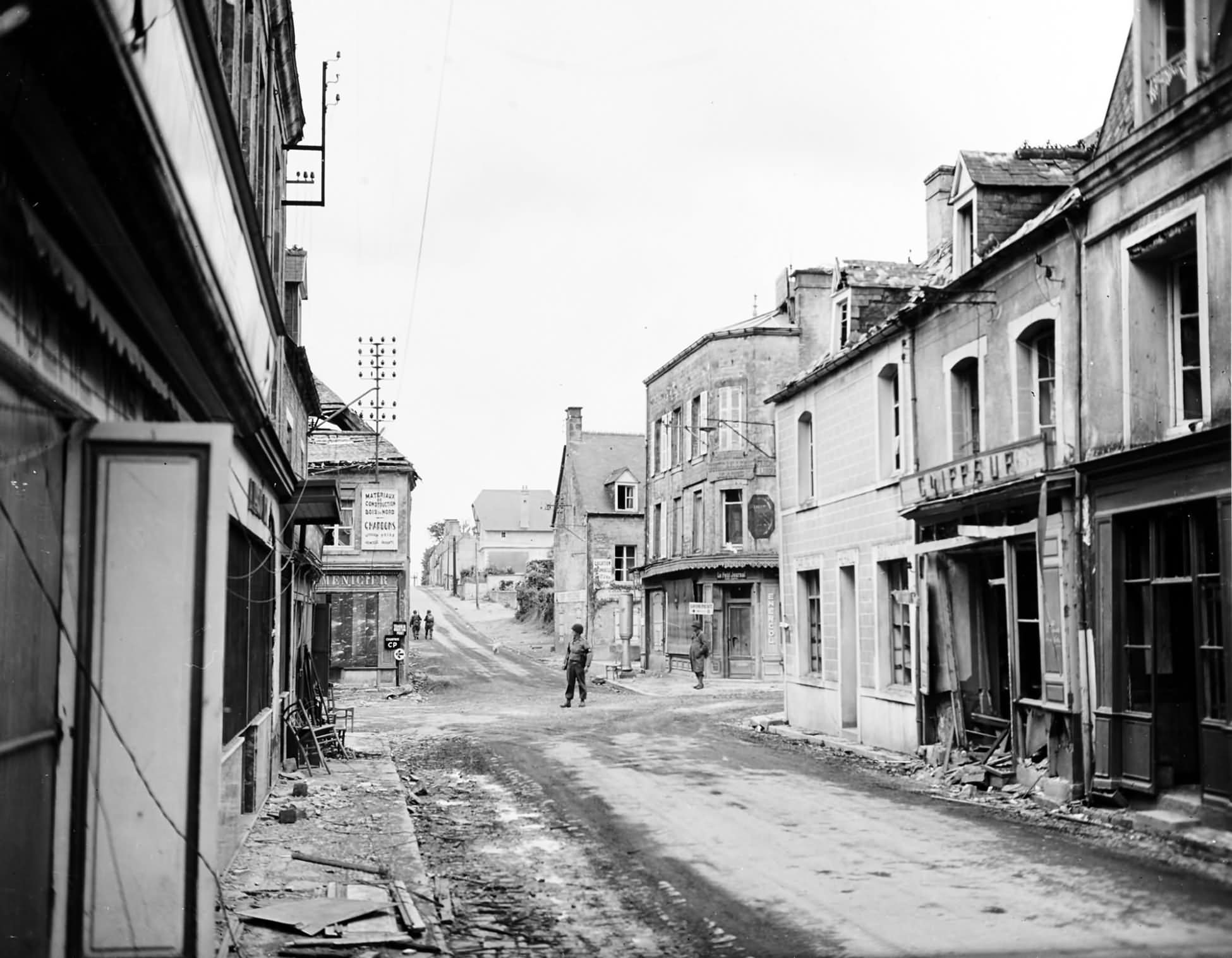Street scene in St. Mere Eglise after its capture by the US Army 10 June 1944