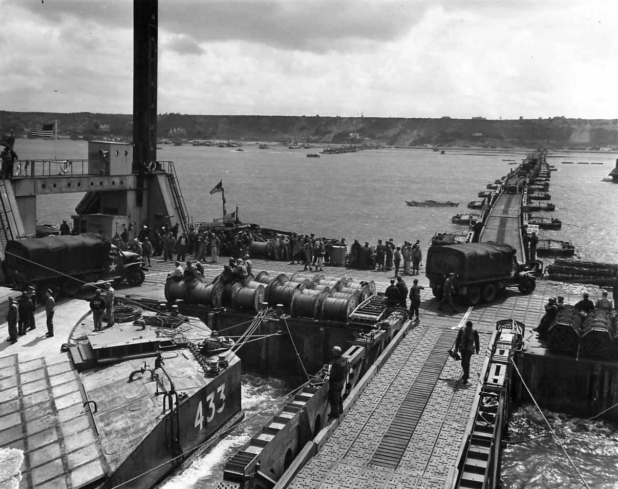 Supplies flow over Mulberry B Harbor at Gold Beach Arromanches