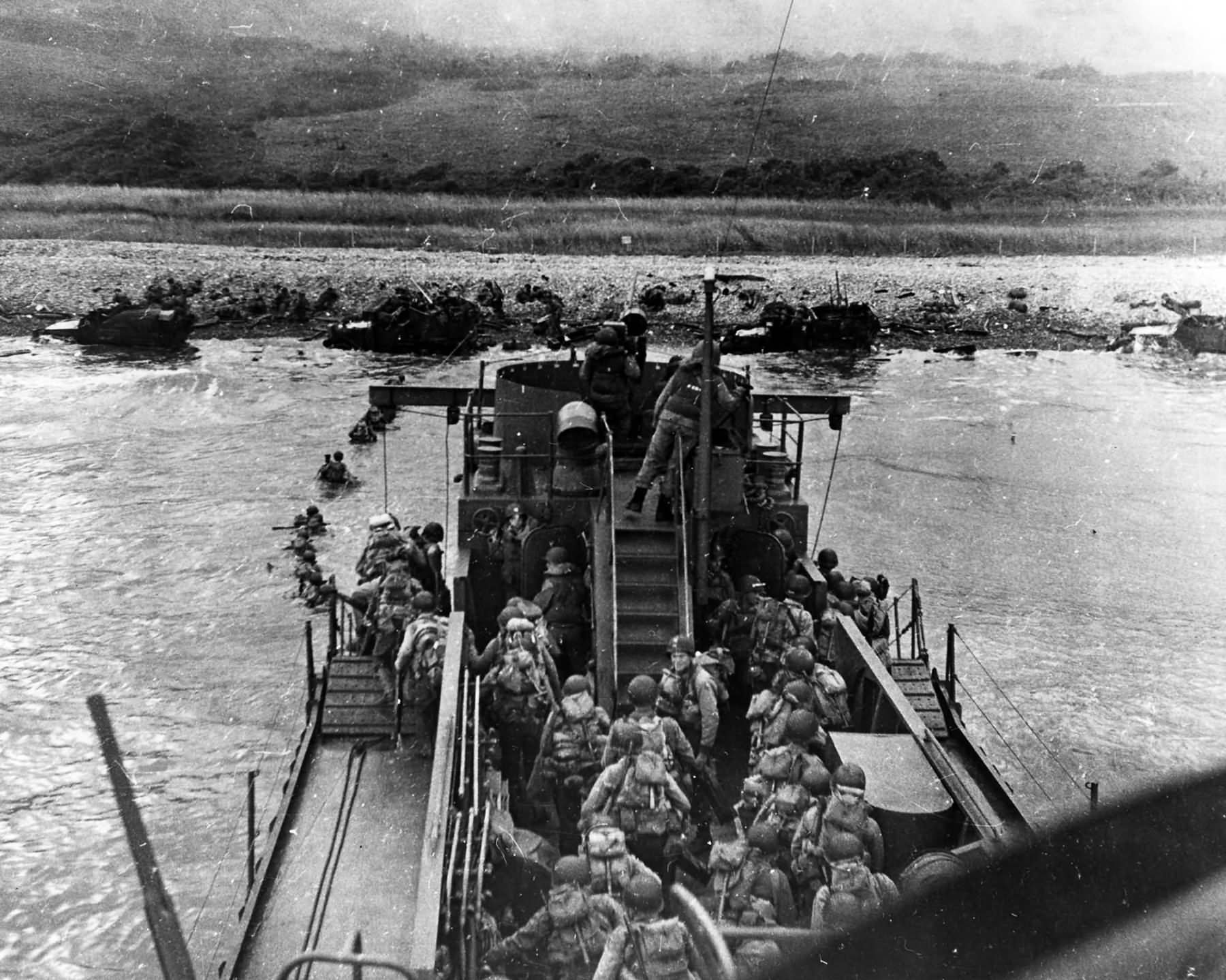 US Troops land from USS LCI(L)-412 during the D-Day assault on Omaha Beach, 6 June 1944