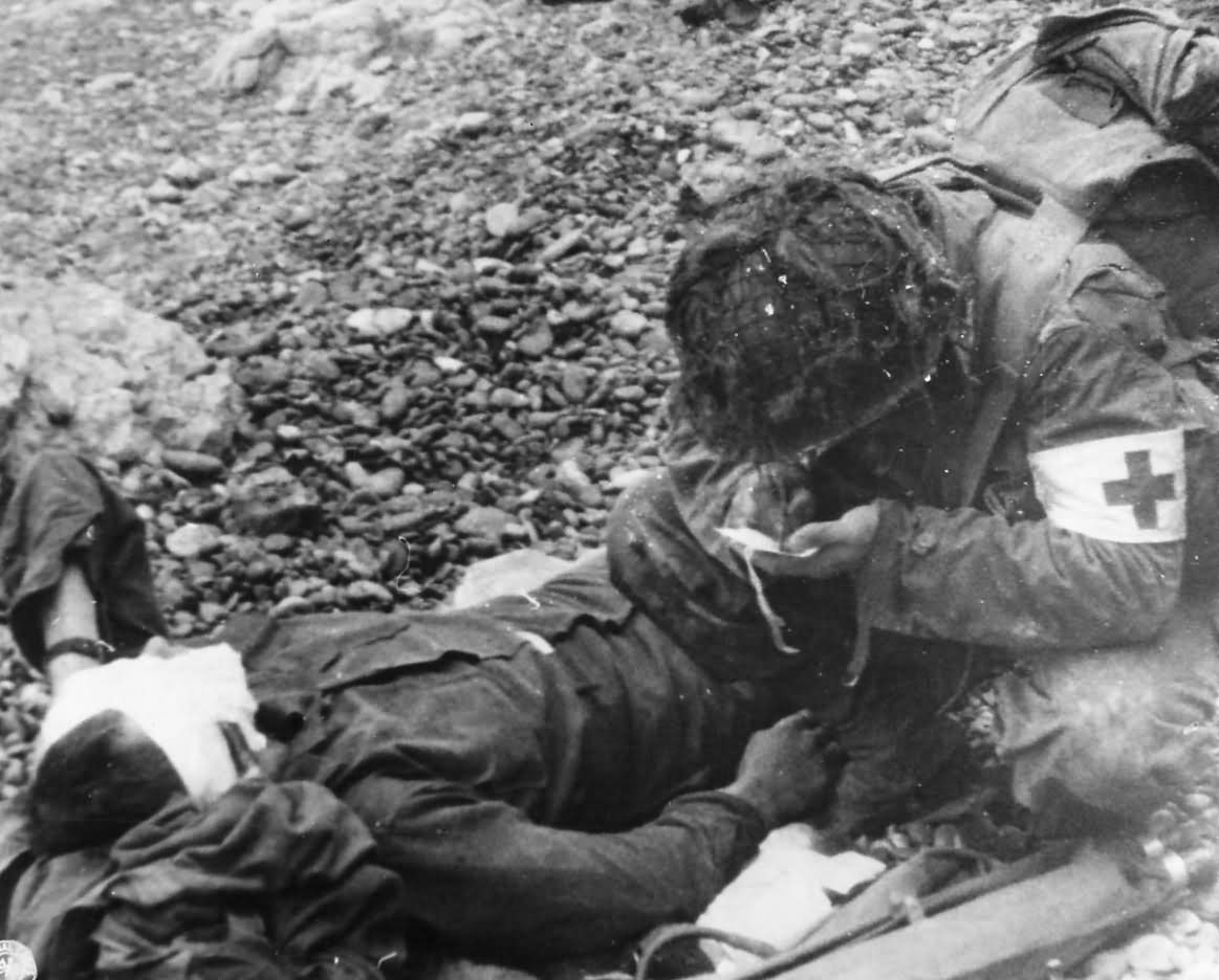 US 1st Infantry Division Medic with Wounded Soldier on Omaha Beach D-Day
