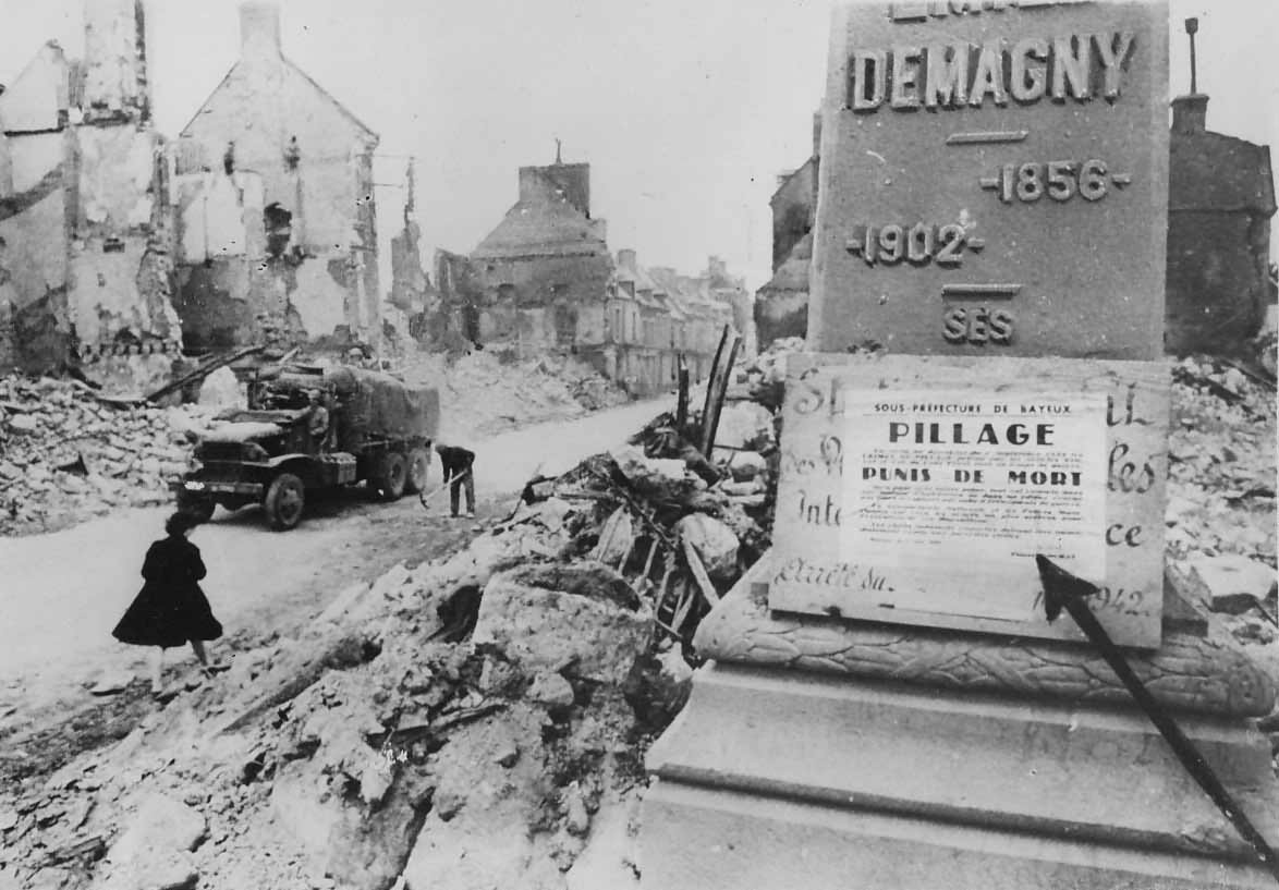 US Army CCKW truck in bombed ruins of Isigny
