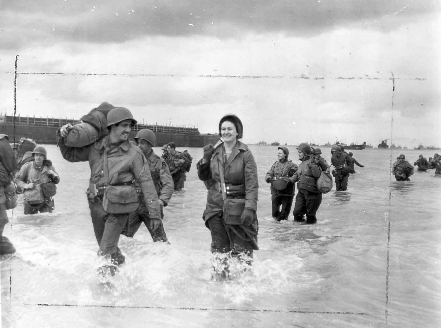 US Army Nurses wade ashore Omaha Beach 12 June 1944