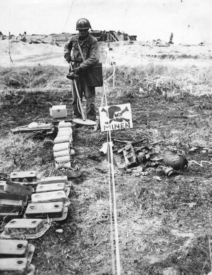 US Army Soldier in German Mine Field in Normandy France 1944