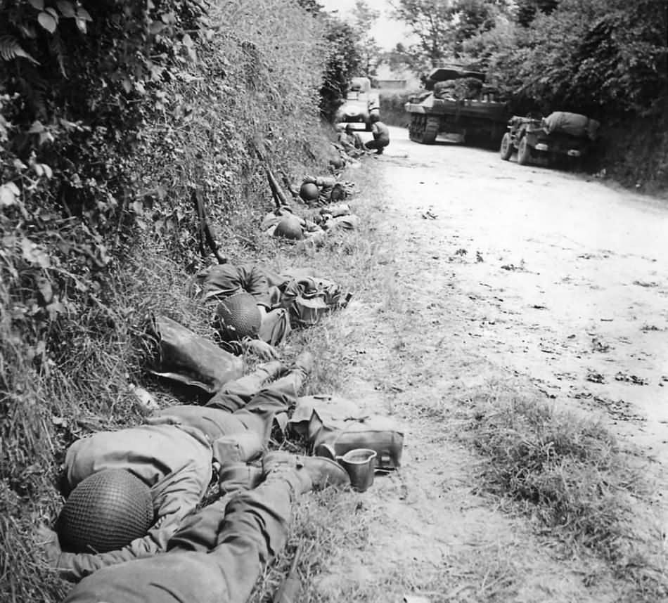 US Army Troops Rest in Ditch During Advance on Cherbourg June 1944 Normandy