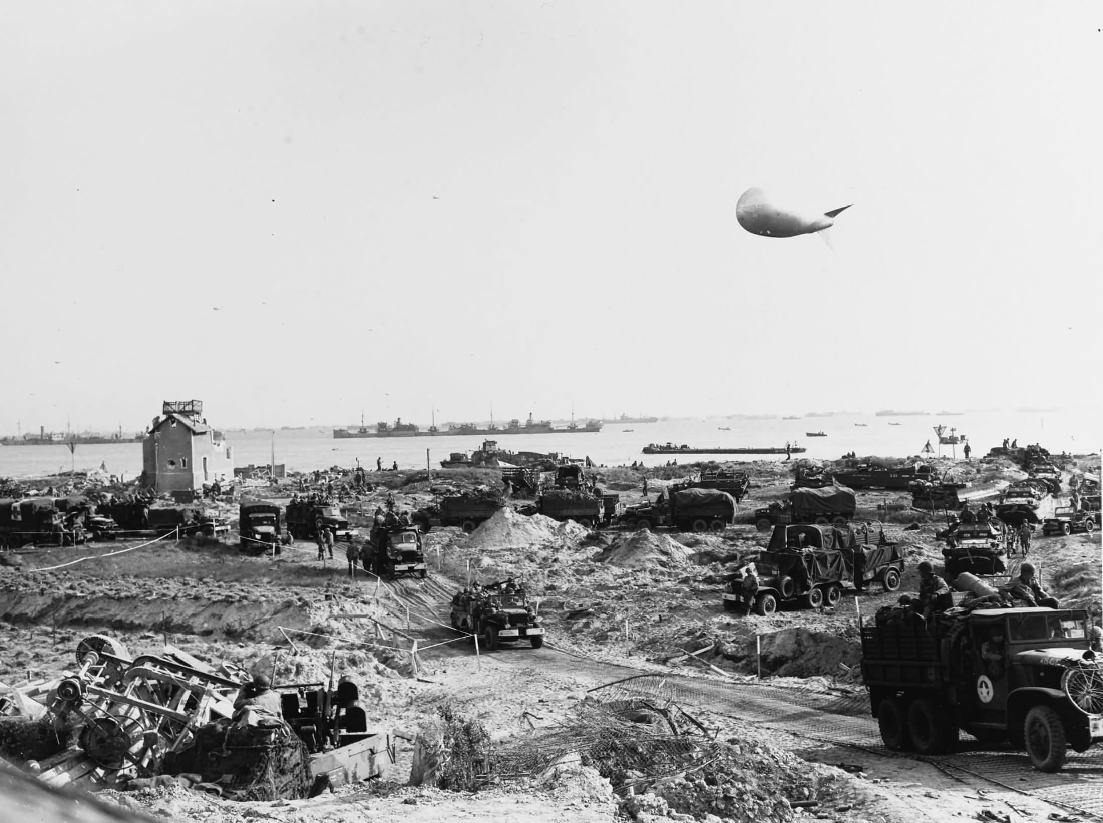 US Army trucks move inland from Omaha Beach