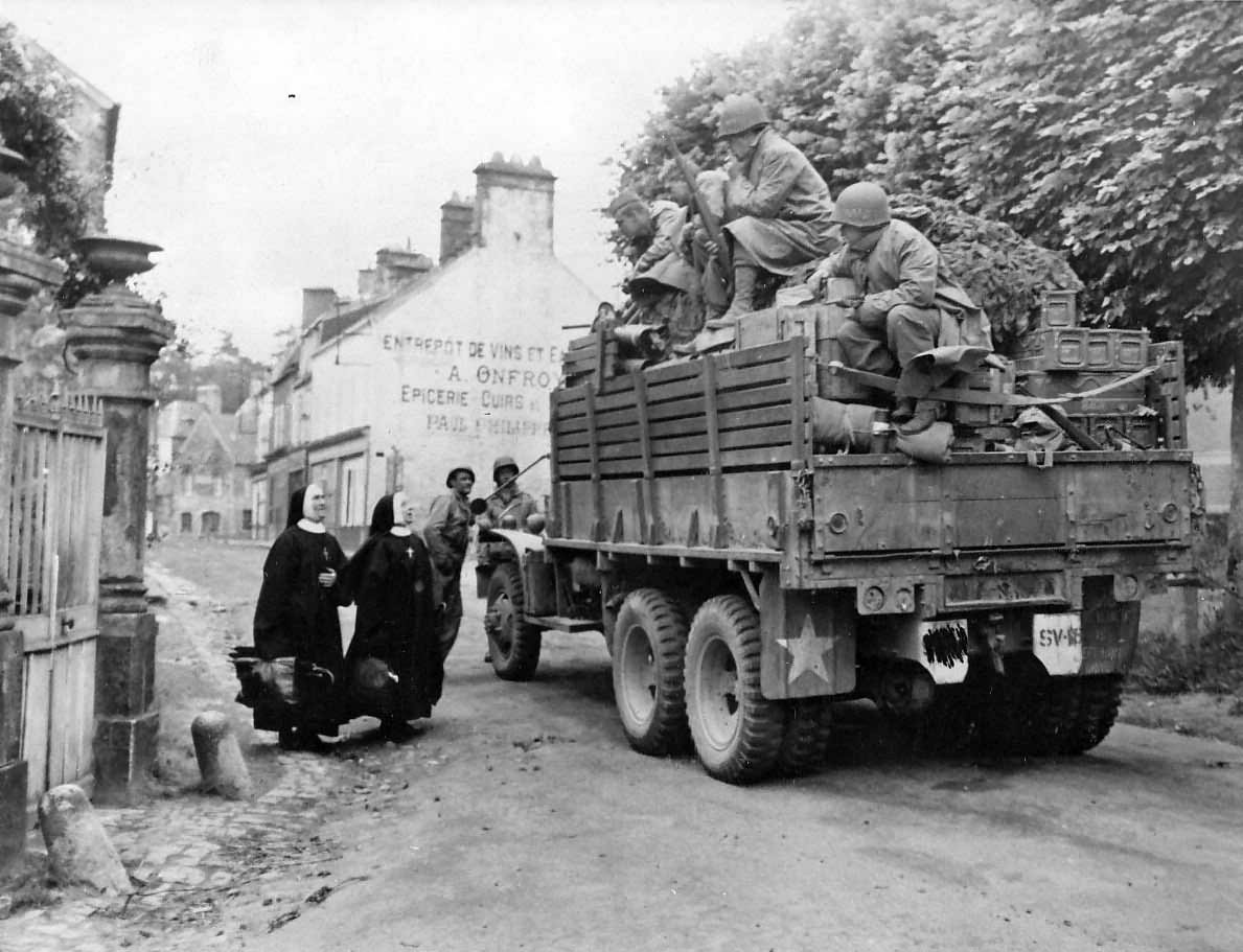 US Infantry in truck liberated Bricquebec Normandy 1944