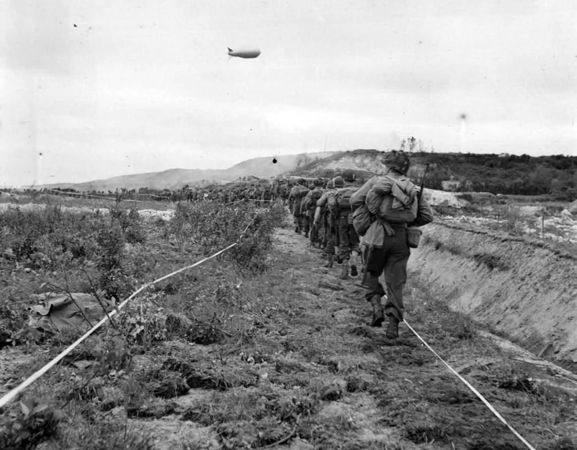 US Infantrymen Advance thru German Minefield in Normandy 1944