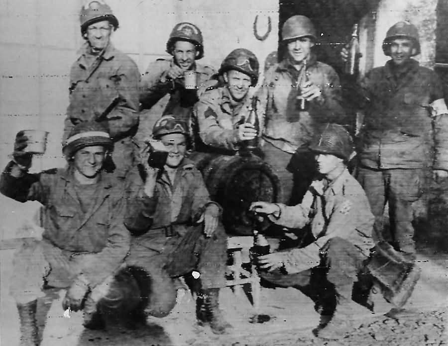 US Troops Celebrate with French Wine in Normandy 1944