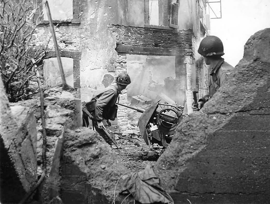 US soldiers hunt for a Germans in a shell torn building in Cherbourg France 1944