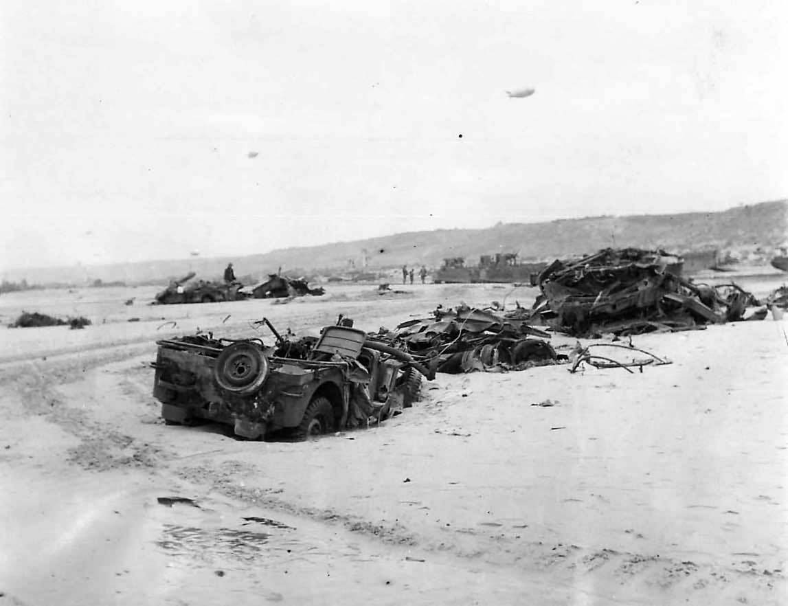 Wreckage of Jeeps and Armored Vehicles on D-Day Beachhead 1944