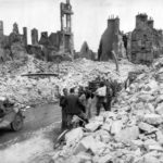 Truck in bombed ruins of Valognes