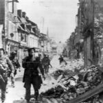 US Army Troops take bombed Carentan