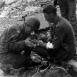 US Medical Officer treats wounded German on Normandy Beach