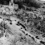 US Tanks and trucks move into ruins of Periers