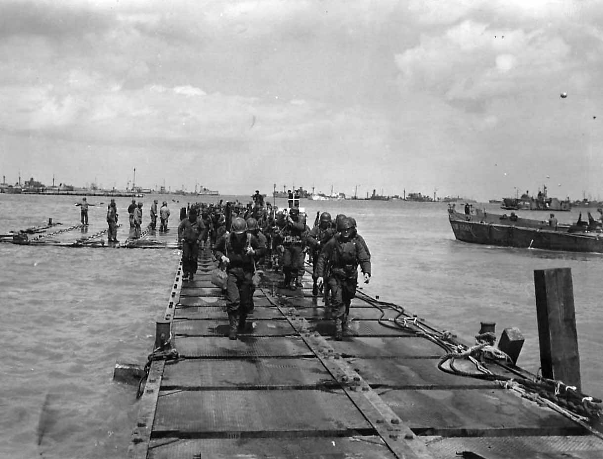 US troops coming ashore on Mulberry A on D-Days Omaha Beach at Saint Laurent Sur Mer