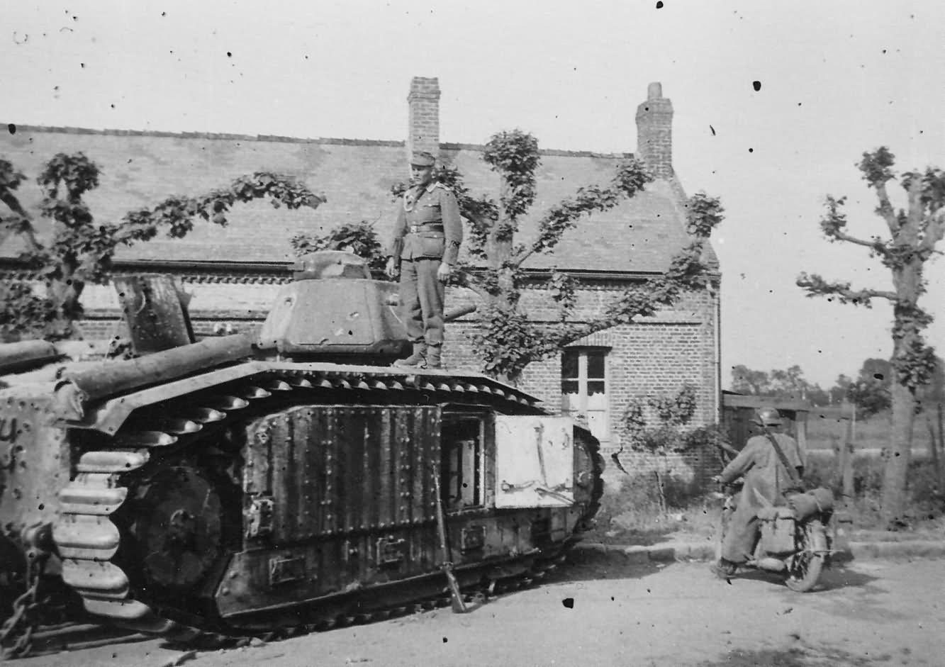 German soldier posing atop a Char B1 bis tank