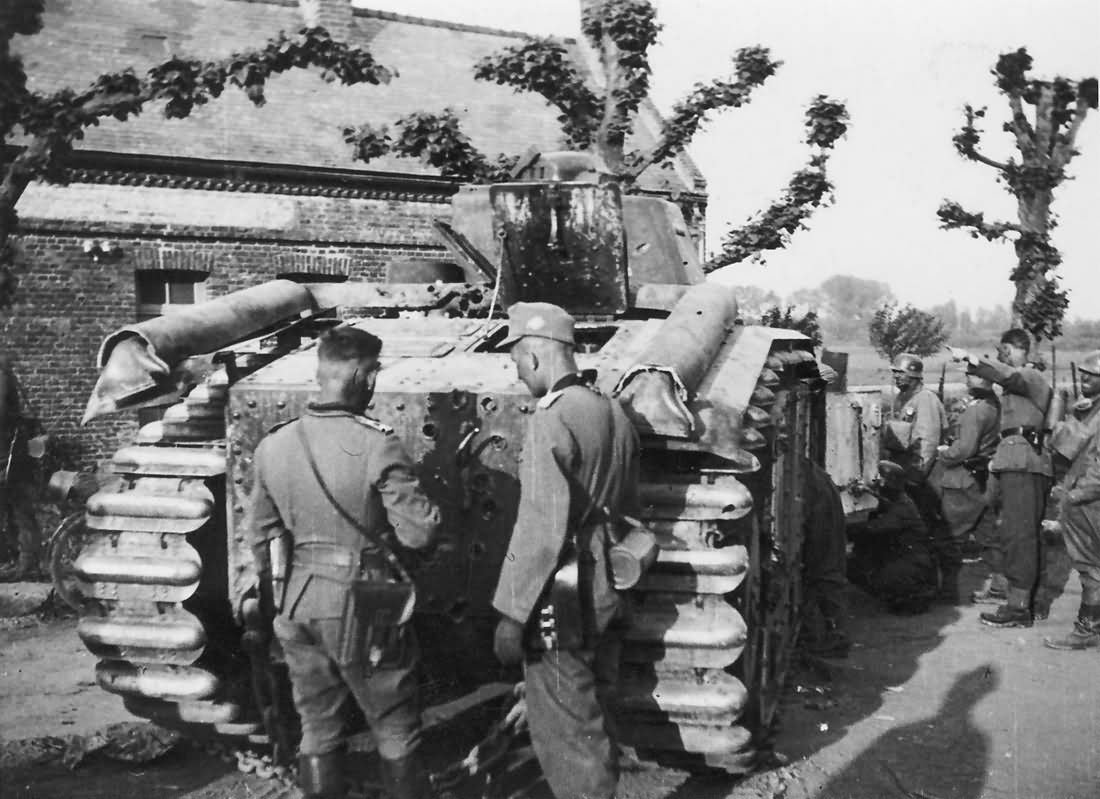 German soldiers examining knocked out Char B1 bis tank