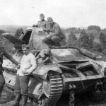 wehrmacht soldiers next to a FCM36 tank