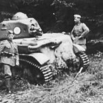 German troops pose next to a captured and damaged Renault R-35 tank