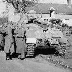 German troops pose next to a captured and damaged Somua S35 1940