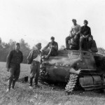 German troops pose next to a captured and damaged Somua S35