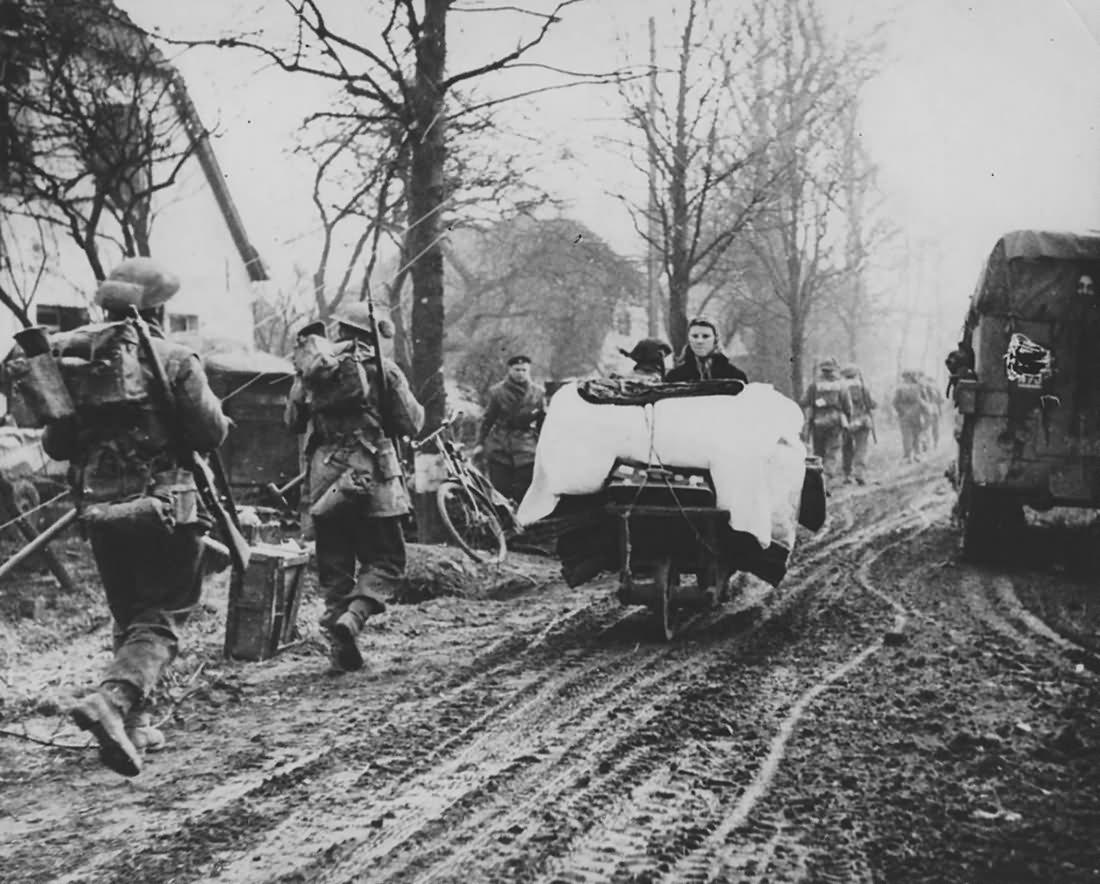 German Civilans Passing Canadian Infantry Kalkar 1945