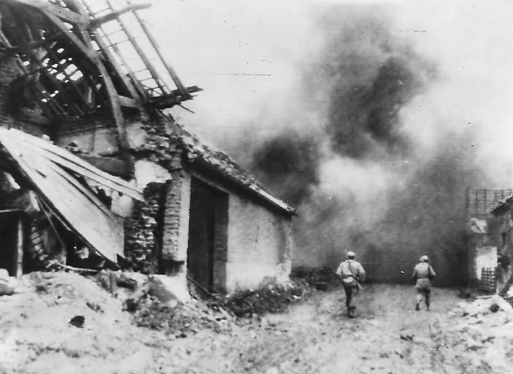 US 1st Army Soldiers Advance thru Burning Merzenich 1945