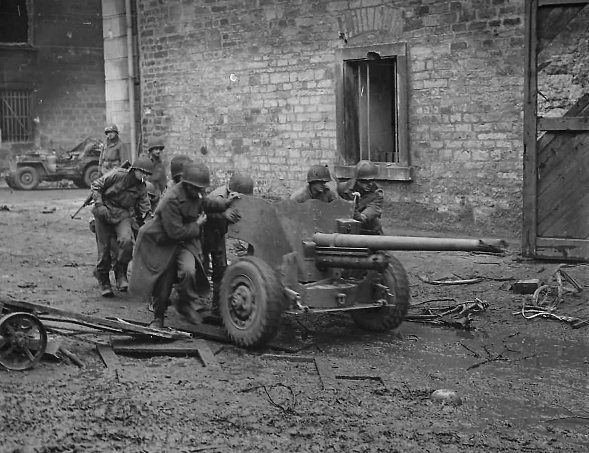 US 3rd Army Troops Roll 57mm Gun through the streets of Town on Saar Front 1944