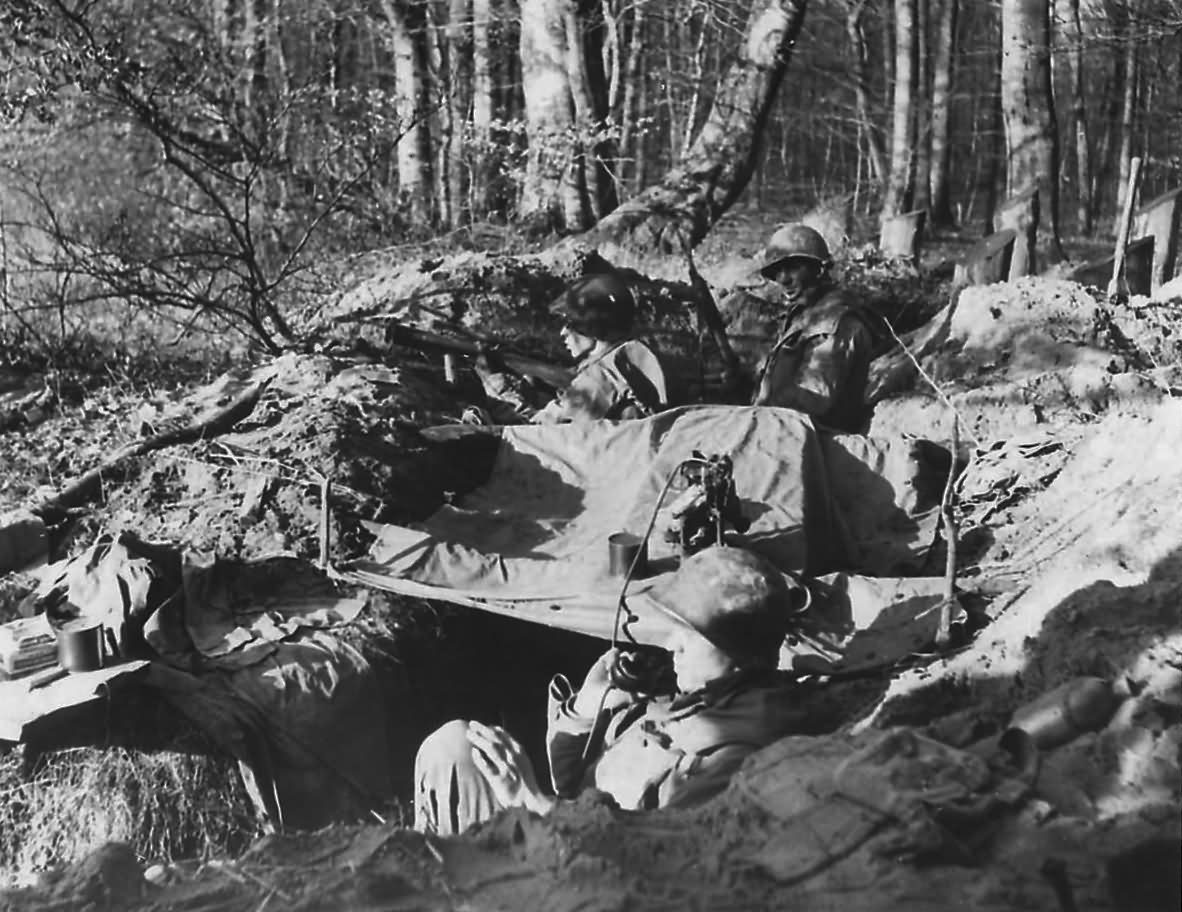 US 7th Army Troops in Foxhole in Bienwald Forest Scheibenhardt Germany 1945